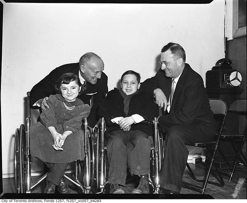 Conn Smythe with children in wheelchairs   by Toronto History