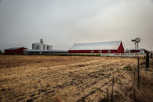 solemn colorful landscape sky fence silo oregon windmill serious farm quiet field barn clouds arlington unitedstates us