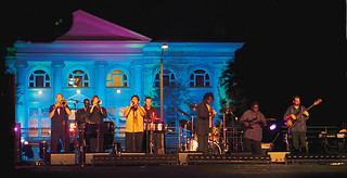 A salsa band plays on the Quad with a brightly lit Carnegie in the background as part of the day-long celebration of the inauguration of President David Oxtoby in 2003.