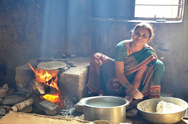 school cook making millet chapattis