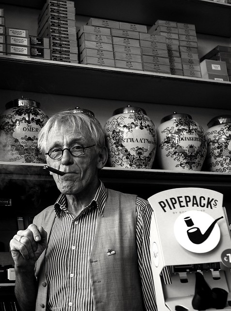 The man and his tabacco store.