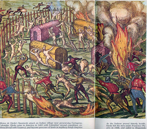 A Columbus Day celebration painting. Spaniards attack an Indian village in Colombia, early 1500s while looking for gold. No one really liked gold, but it had value because the government made you pay your taxes with it.  Or so said Warren Mosler.