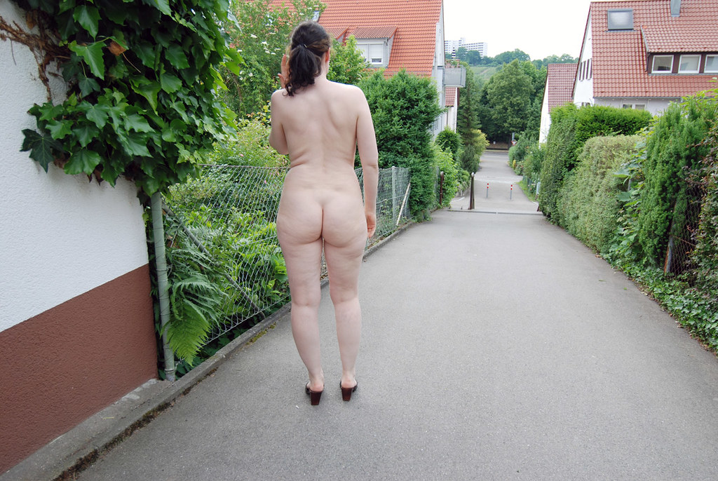 Wives teasing nude beach voyeurs gives one a handjob