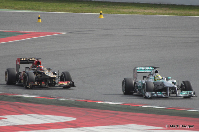 Kimi Raikkonen in his Lotus and Nico Rosberg in his Mercedes at Formula One Winter Testing, March 2013