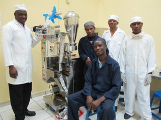 The operational team at Pharmanova with the ORS sachet machine | by ColaLife