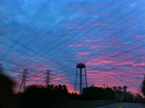 sunlight water clouds sunrise nc tank northcarolina wires electricwires iphone highway70 iphone4