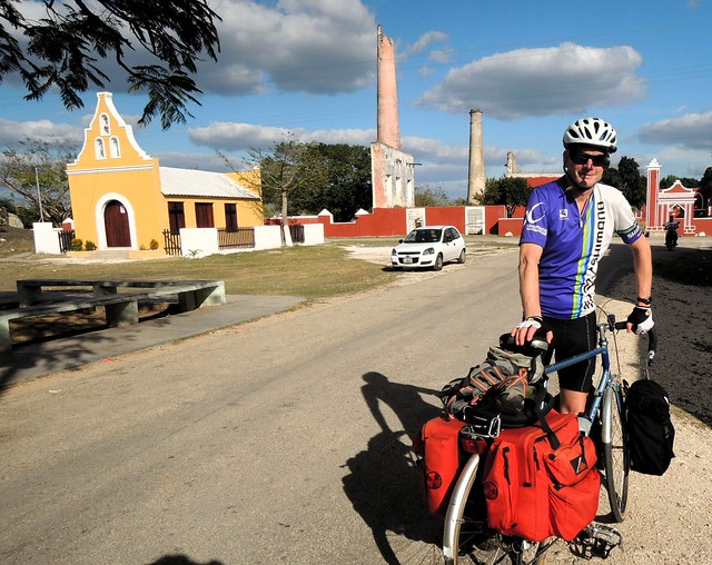 A church, an old hacienda, and a cycle tourist by bryandkeith on flickr