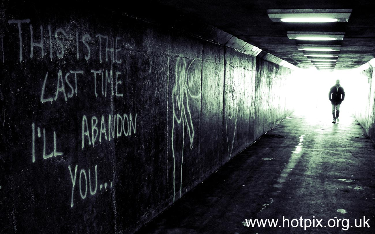 spooky,man,walking,through,an,underpass,under,pass,b/w,black,white,black and white,rudheath,walkway,walk,way,Northwich,Cheshire,A556,spray,paint,England,UK,menace,danger,This is the last time,I will abandon you,this is the last time I will abandon you,grafitti,graffiti,AFOTANDO