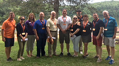 Group at Camp Sloper with Reps. Sampson, Fusco and members of the YMCA team.