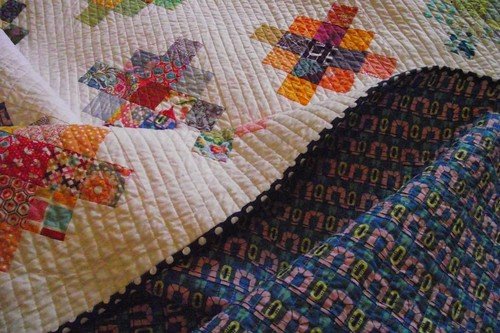 Front and Back of Scrappy Granny Quilt