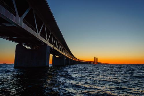 bridge blue sunset orange water dark boat day waves sweden steel structure clear explore malmö beams øresundsbridge skånecounty