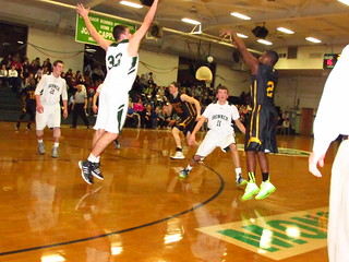 In this 2013 game, McDevitt's Dural Watson fires a trey as B-P's Pat Vanderslice contends. | by tedtee308