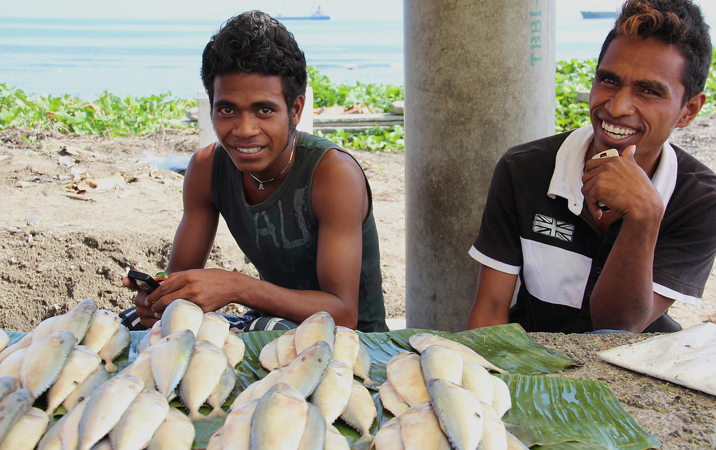 Young men leveraging on technology in fish value chains. Photo by Holly Holmes