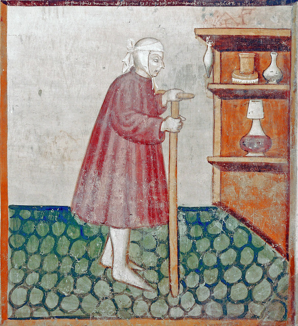 August - The sick man walking on a crutch to his sideboard with medicines
