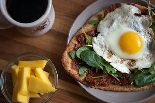 Naan w/Sun-Dried Tomato Paste, Greens, and a Fried Egg   by epiøne