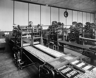 Automatic chocolate coating machines, MacRobertson Chocolate factory   by State Library Victoria Collections