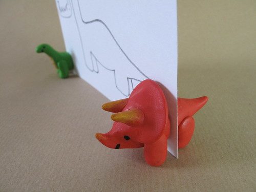 Fimo dinosaurs holding a card | by lilspikey