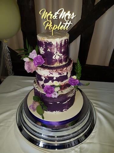 Three tiered semi-naked wedding cake | by platypus1974