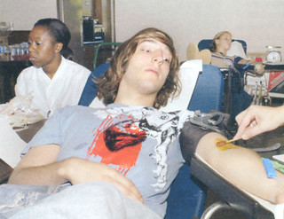 After Hurricane Katrina in 2005, students rallied together to raise $3,000 to donate to the American Red Cross Disaaster Relief Fund and gave more than 100 pints of blood. In this photo, Nick Noble '08 is donating blood.