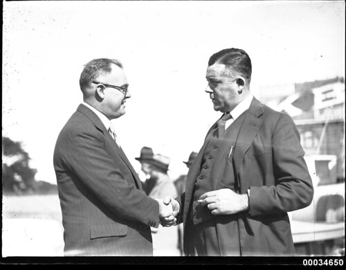 Two men, including Stanley S Crick, shaking hands at a Movietone event | by Australian National Maritime Museum on The Commons