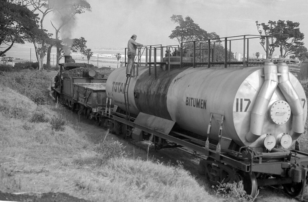No 6 is descending the short but steep pinch with oil pots from the Boral Depot, Botany Freight Line, Matraville, NSW, circa 1973.