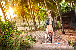 Handstand with Garudasana Legs of Hawah near fisherman hut at sunset in India. Photo taken by Alex and Marina Photography.   by everlutionary