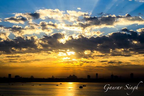 morning sea sky orange sun india clouds sunrise rising colorful rays sunrays