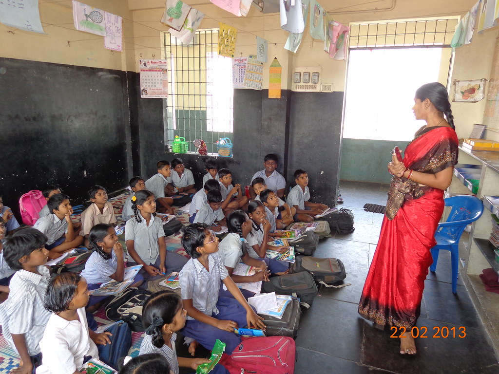 A primary school in Chennai, India | A teacher and her atten