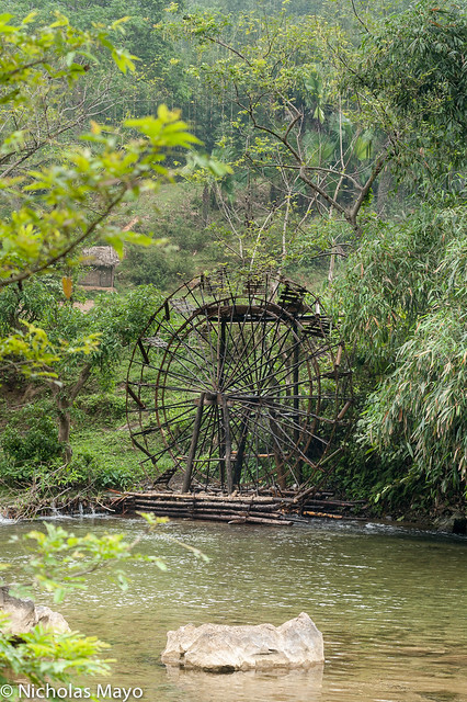 Water Wheel On A Placid River