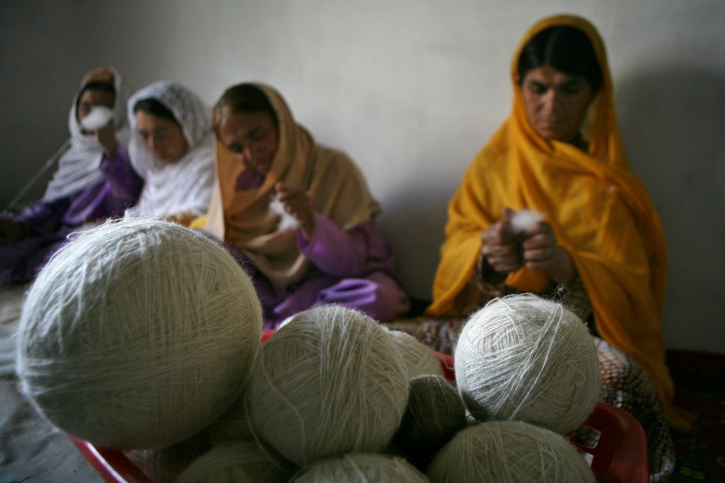 Disabled women weave at a women empowerment workshop.