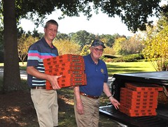 Unloading Ed Smallwood's truck are Curtis Stevens and Ed Smallwood. The pizzas are from North Raleigh Rotarian Mike Aoun.
