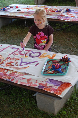 Girl painting at Merlefest 2013 | by virgohobbs
