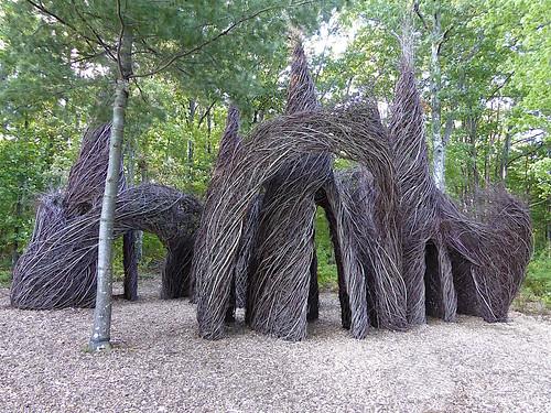 art sculpture stickwork branches saplings weave woven natural landscape arches spires