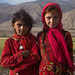 Portrait of afghan girls dressed in red clothes, Badakhshan province, Qazi deh, Afghanistan by Eric Lafforgue