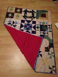 Scrappy quilt complete.