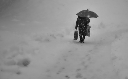 Old woman in the snowstorm | by Tomislav C.