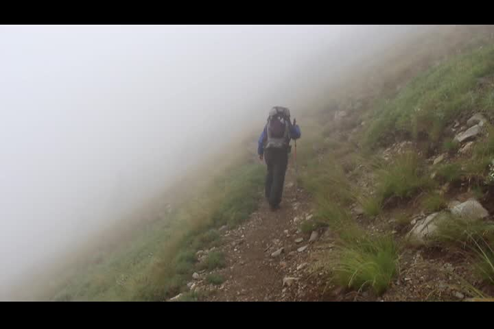 1730 PCT Video - Vicki hiking into the clouds on the PCT above Glacier Pass