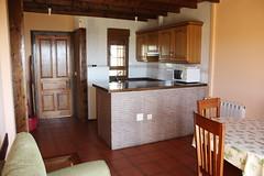 Cocina, salón, comedor. Apartamentos Tezán