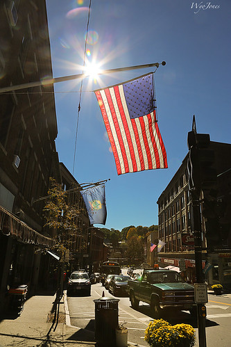 sun bus cars buildings downtown vermont view flag pickup sidewalk backlit np intothesun sunflares wyojones brattleboromainstreet