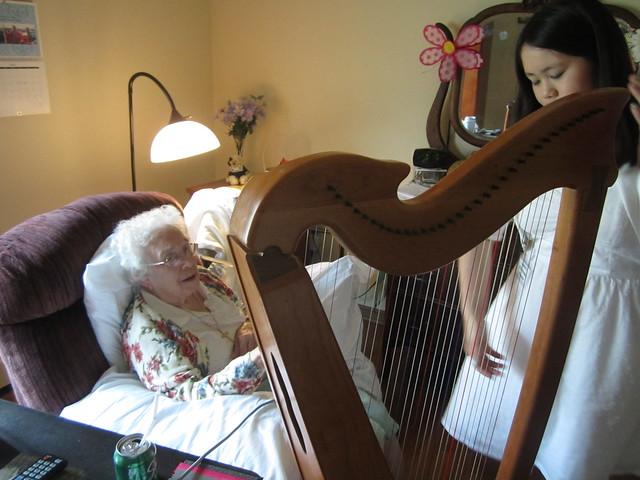 Sophia explaining the harp to Betty