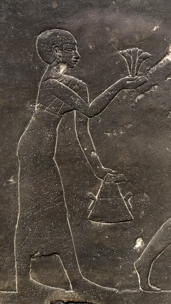 Egyptian limestone slab with relief representing women pressing lotus flowers (detail)