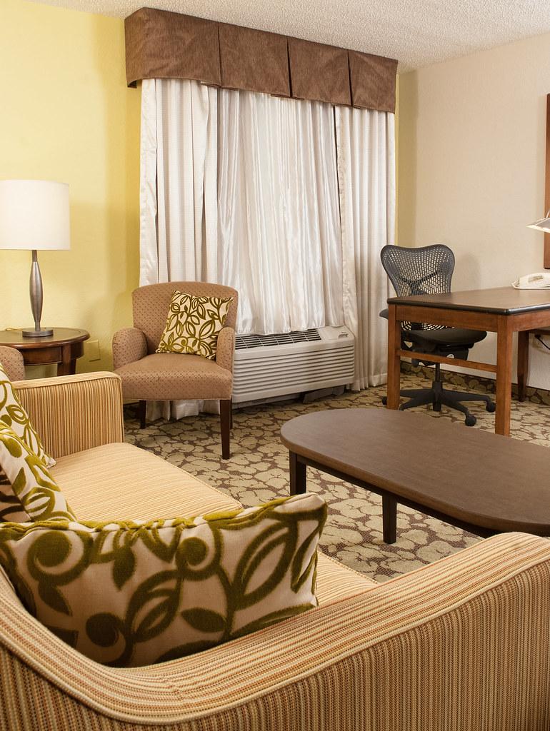 Hilton garden inn orlando airport guest room suite livin - Hilton garden inn orlando airport ...