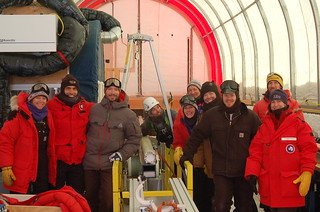 Group picture after drilling/collecting the first ice core with the Intermediate Depth Drill. | by U.S. Ice Drilling