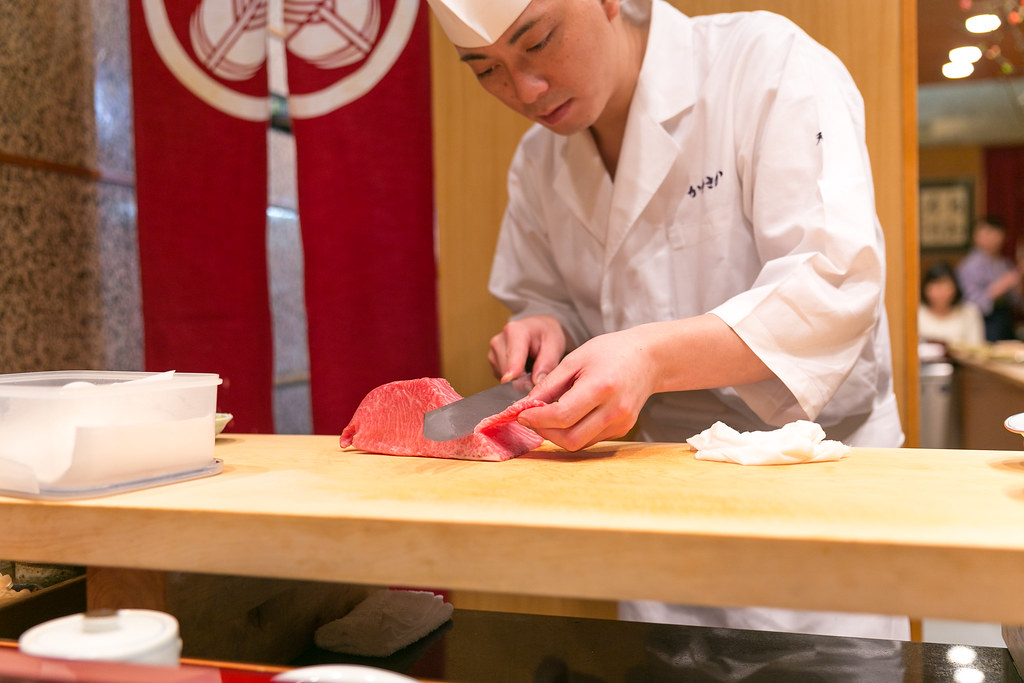 Chef Takashi Usuba cutting tuna cheeks
