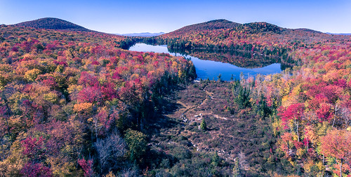 autumn foliage water reflections aerial fall orange red pond fallcolors phantom4 dji vermont stream drone kettlepond groton landscape mountains yellow statepark newengland unitedstates us