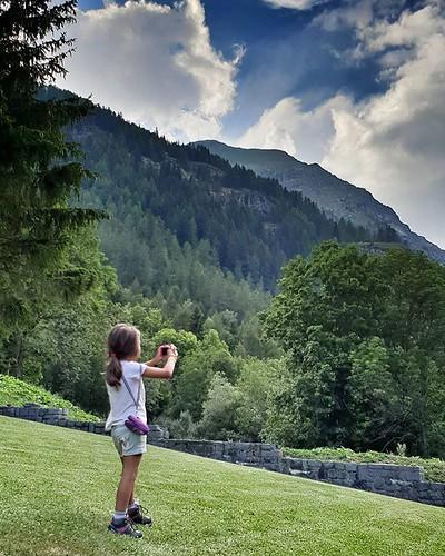 Taking pictures #mountain #gressoney #valdaosta #family #fun #photographs #kid #play #life #igers #igersitalia #travelgram #clouds #cloudy #photooftheday #picoftheday #green #grass #garden | by Mario De Carli