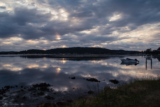 Cloudy sunrise and reflections on the bay
