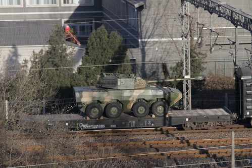 People's Liberation Army 8X8 wheeled self-propelled gun loaded on a military train