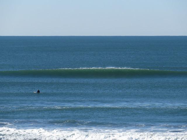 Surfer and wave at Ocean Beach, San Francisco; January 1, 2015