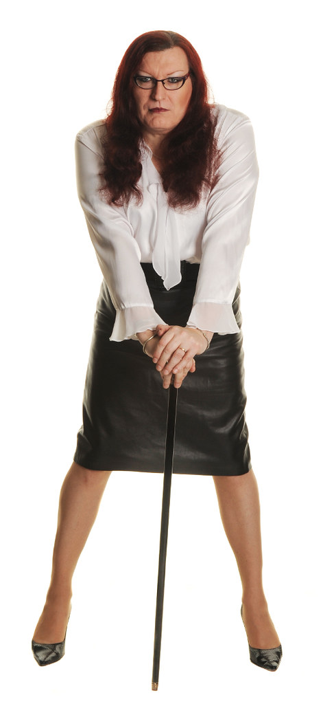 d6a7281d6580f ... white satin blouse black leather skirt with cane